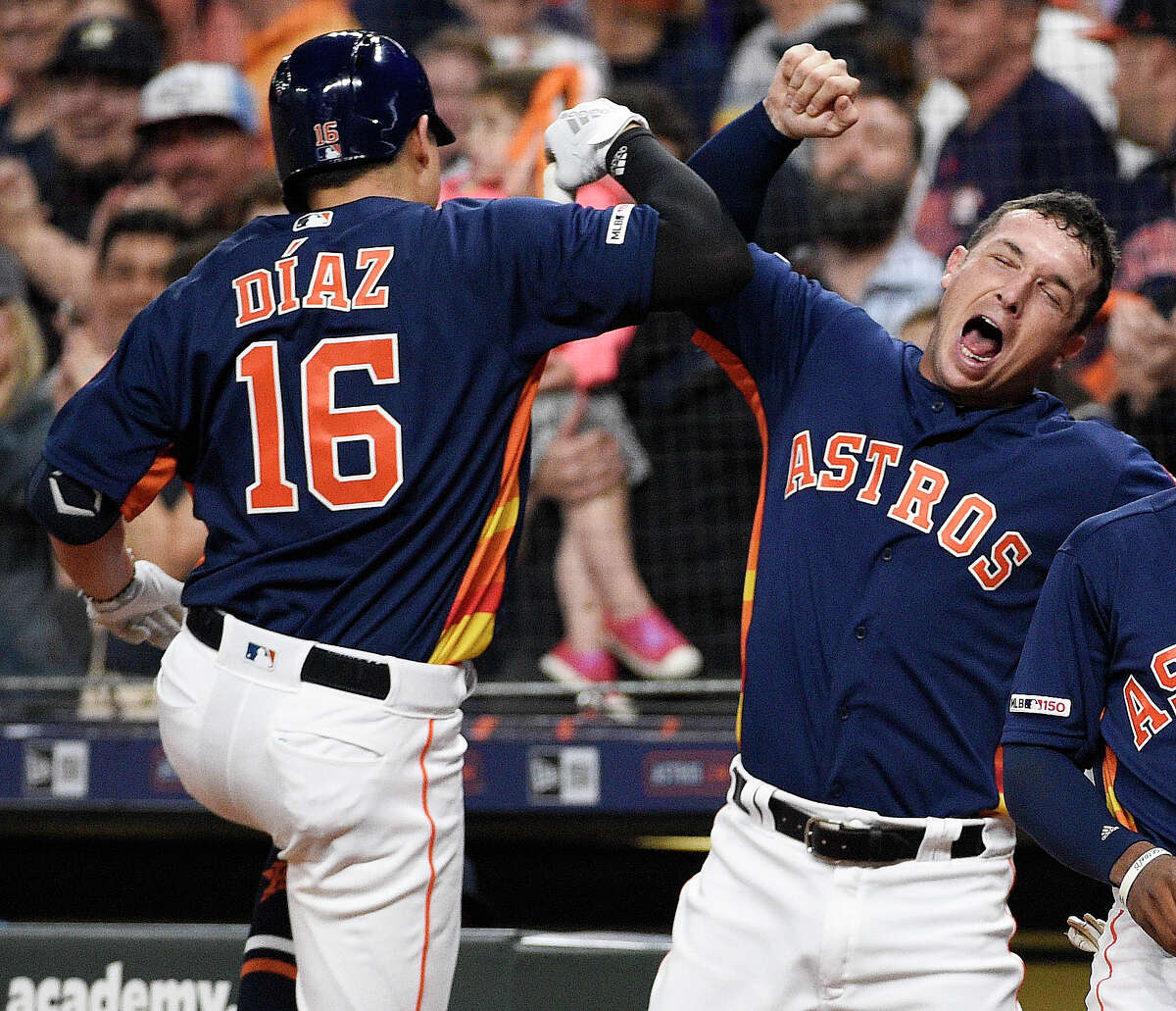 Houston Astros' Aledmys Diaz (16) celebrates his three-run home run off Oakland Athletics starting pitcher Mike Fiers with Alex Bregman during the first inning of a baseball game, Sunday, April 7, 2019, in Houston. (AP Photo/Eric Christian Smith)