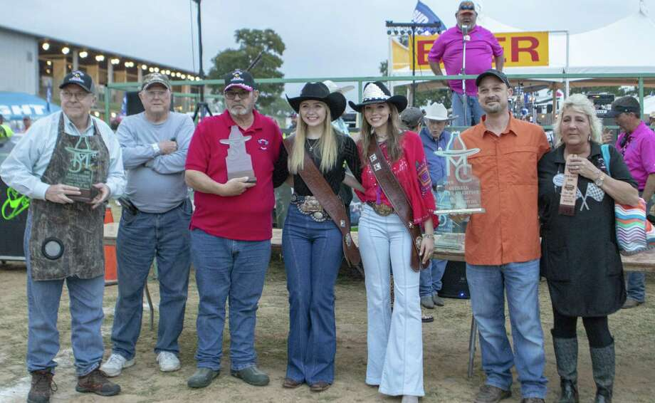 Members of Ritch's Raiders pose with all of their awards after being named overall grand champions during the awards ceremony for the Bud Light BBQ Cook-Off on Saturday, April 6, 2018, at the Montgomery County Fair & Rodeo in Conroe. Photo: Cody Bahn, Houston Chronicle / Staff Photographer / © 2018 Houston Chronicle