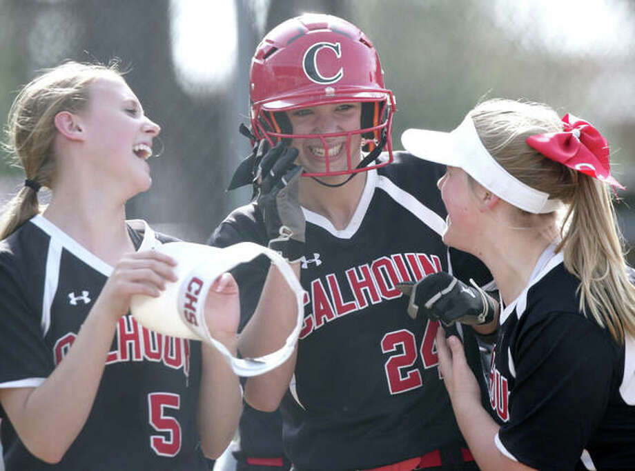 Calhoun sophomore Lucy Kallal poses at home plate Saturday after hitting seven home runs in three games at the Beardstown Tournament. Kallal finished 8-for-9 with seven homers and 14 RBIs in wins over Springfield, Beardstown and Carthage Illini West. Lucy Kallal (middle) is greeted by teammates after hittting her second three-run home run in the first inning against Carthage Illini West in the championship game of the Beardstown Tournament. In three tourney games Saturday, Kallal finished 8-for-9 with seven homers and 14 RBIs in wins over Springfield, Beardstown and Illini West. Photo: Dennis Mathes / Hearst Illinois