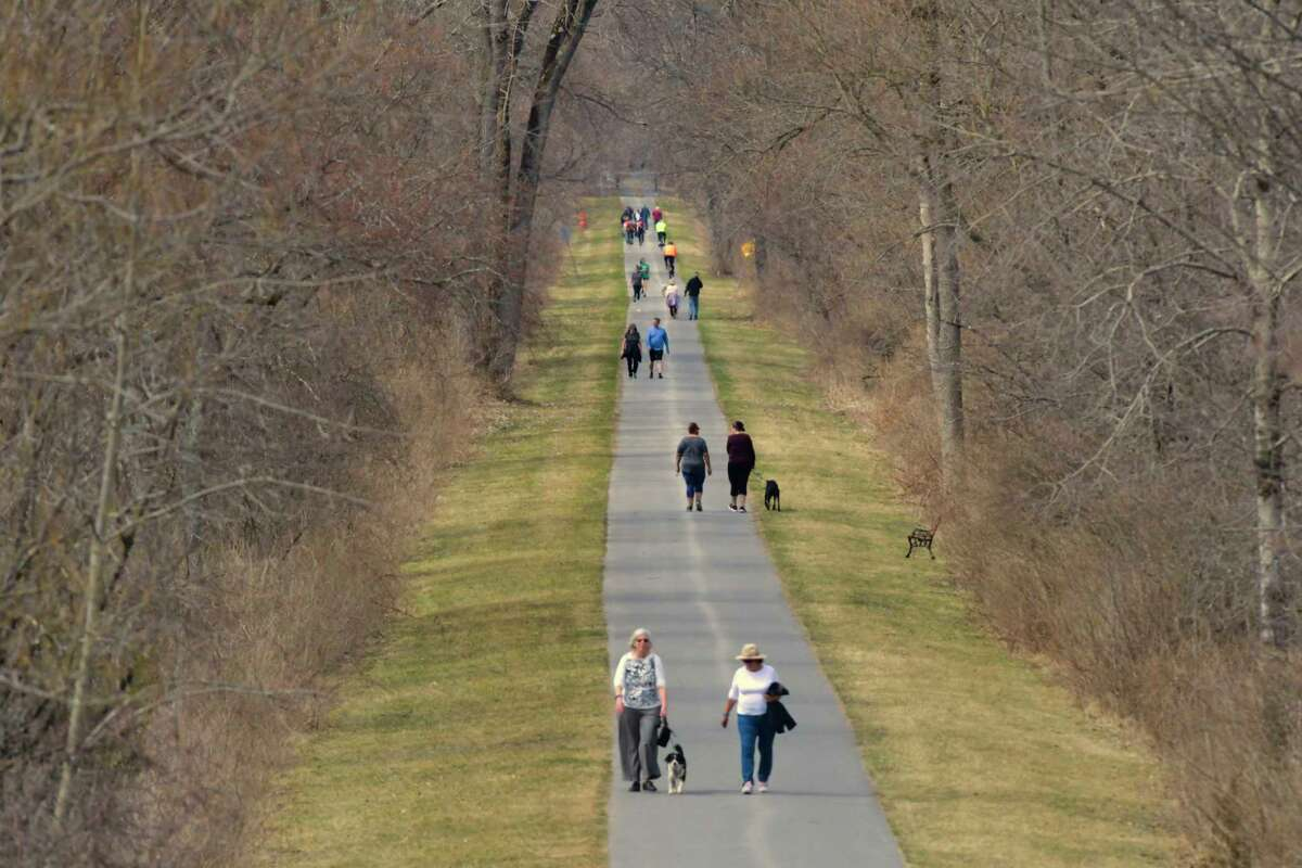 People make their way along the bike path on Sunday, April 7, 2019, in Niskayuna, N.Y. (Paul Buckowski/Times Union)