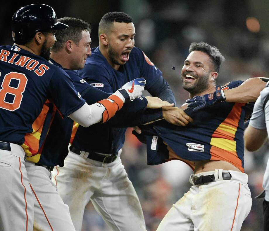 Houston Astros' Jose Altuve, right, celebrates his walk with the bases loaded to win the game during the ninth inning of a baseball game against the Oakland Athletics, Sunday, April 7, 2019, in Houston. Photo: Eric Christian Smith, FRE / Associated Press / Copyright 2019 The Associated Press. All rights reserved.