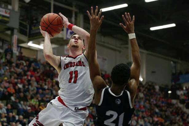 Glens Falls Joseph Girard III, drives to the basket during Saturday?s boys Class B semifinal win over South Brox Prep at the Federation Tournament of Champions. (Erin Reid Coker, Special to The Times Union)