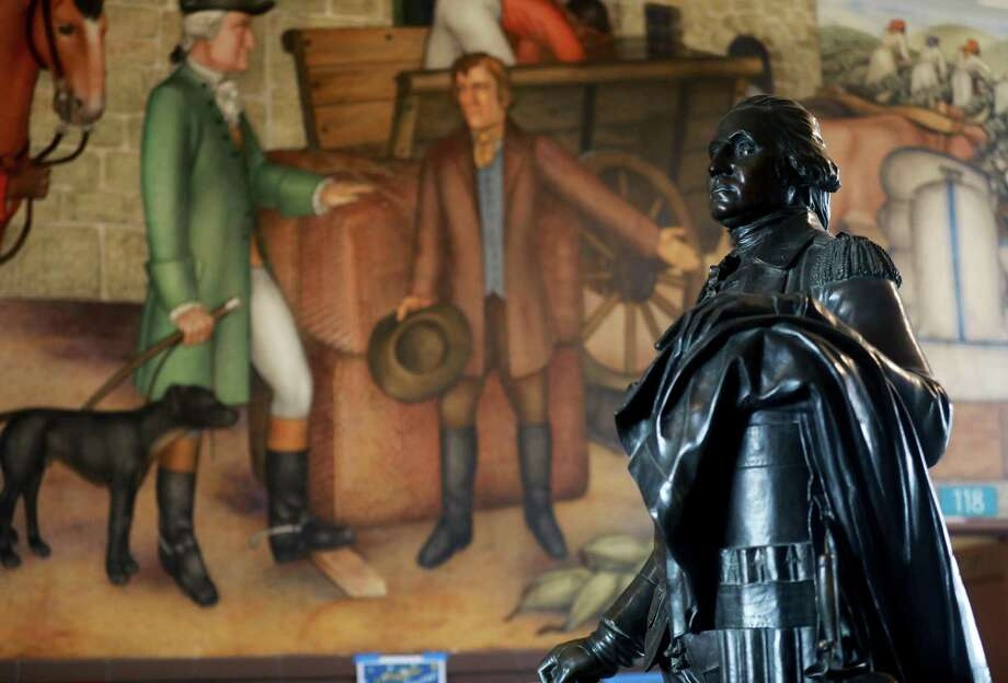 A statue of George Washington stands near the historic mural. Photo: Yalonda M. James / The Chronicle / San Francisco Chronicle