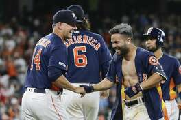 HOUSTON, TEXAS - APRIL 07: Jose Altuve #27 of the Houston Astros celebrates with manager AJ Hinch #14 after his walk forced in the winning run in the ninth inning against the Oakland Athletics at Minute Maid Park on April 07, 2019 in Houston, Texas. (Photo by Bob Levey/Getty Images)