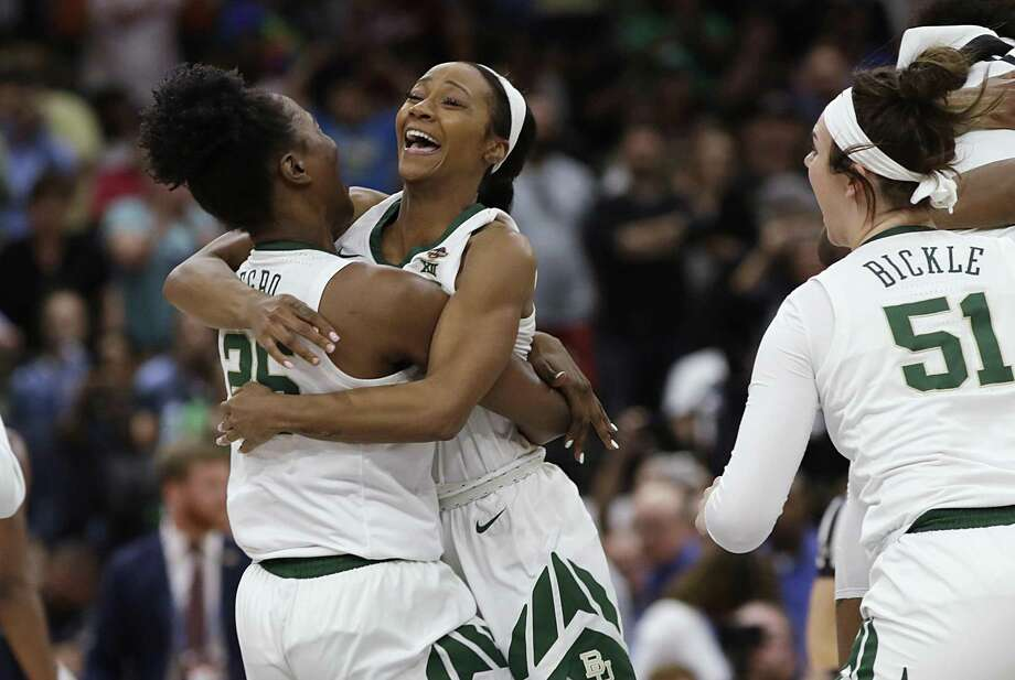 Baylor guard Chloe Jackson (24) hugs center Queen Egbo (25) after Baylor defeated Notre Dame 82-81 during the Final Four championship game of the NCAA women's college basketball tournament Sunday, April 7, 2019, in Tampa, Fla. Photo: Chris O'Meara, STF / Associated Press / Copyright 2019 The Associated Press. All rights reserved.