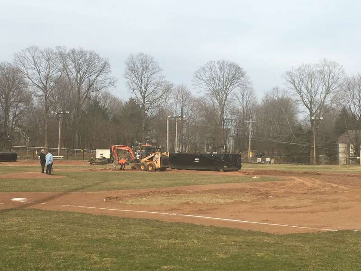 Ridgefield town officials examine the damage done to Ciuccoli Field.