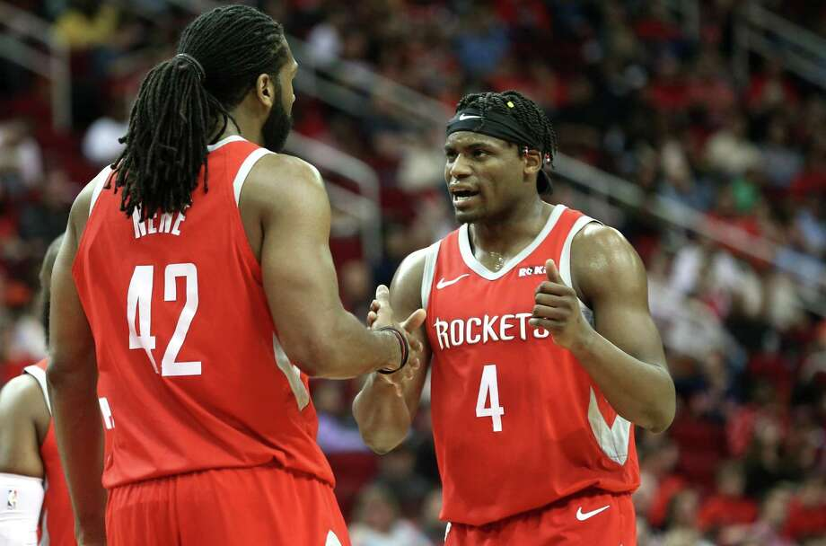Houston Rockets center Nene Hilario (42) and Houston Rockets forward Danuel House Jr. (4) talk on the court during the first half against Phoenix Suns at the Toyota Center on Sunday, April 7, 2019. Photo: Elizabeth Conley, Houston Chronicle / Staff Photographer / © 2018 Houston Chronicle