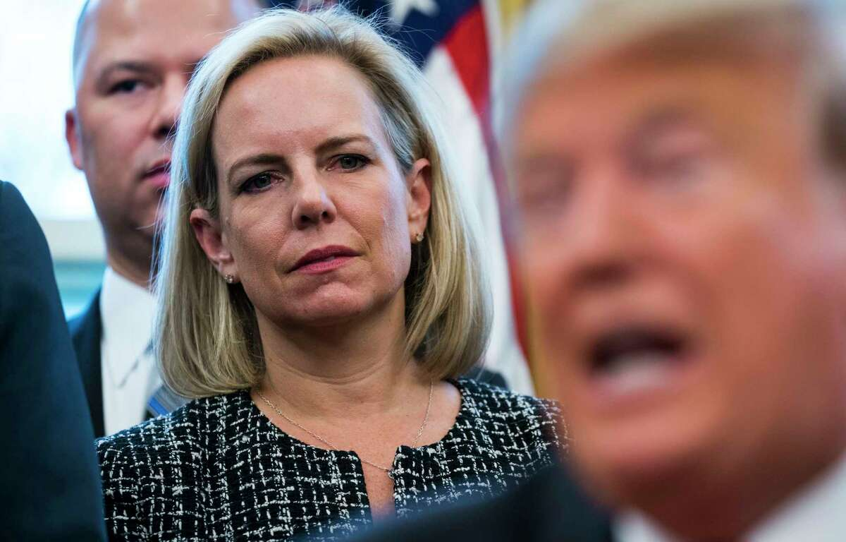 FILE -- Homeland Security Secretary Kirstjen Nielsen looks on as President Donald Trump holds a bill-signing ceremony at the White House in Washington, Jan. 9, 2019. Nielsen left her position on Sunday, April 7, 2019, ending a tumultuous tenure in charge of the border security agency that had at times made her the target of Trump?s criticism. (Doug Mills/The New York Times)