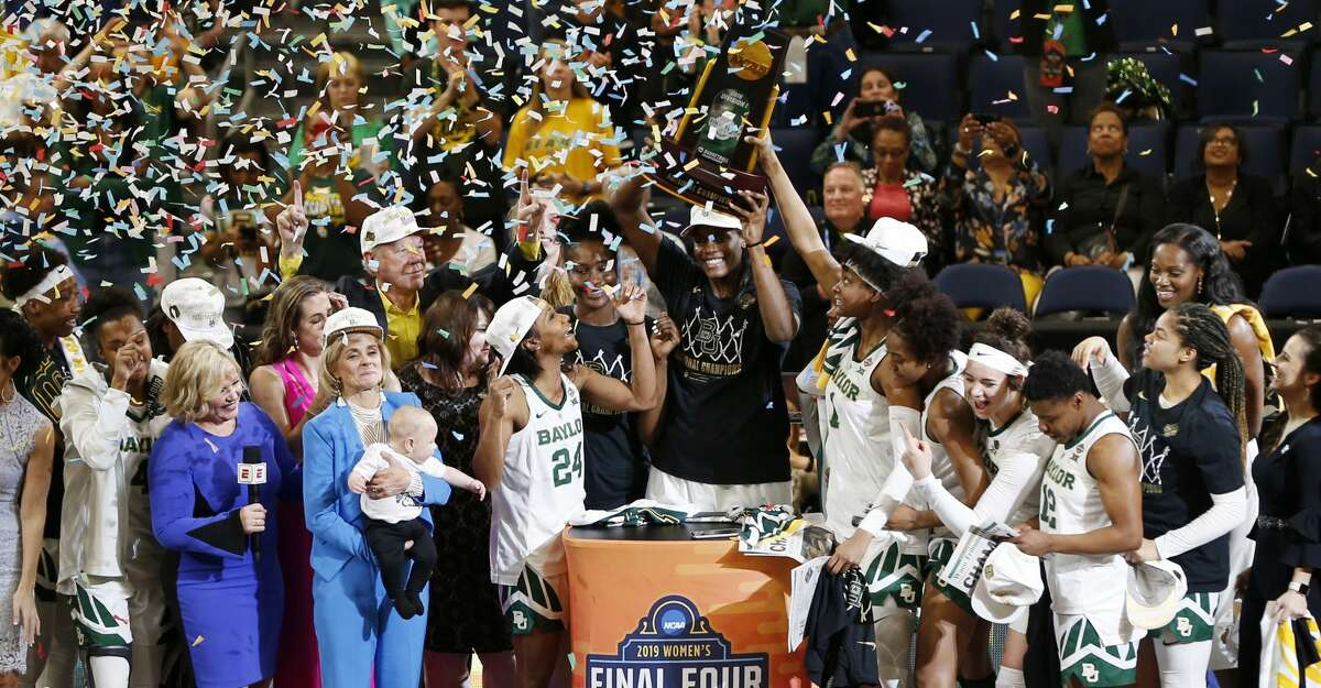 The Baylor team raises the NCAA championship trophy after defeating Notre Dame 82-81, at the NCAA women's college basketball tournament, Sunday, April 7, 2019, in Tampa, Fla. (AP Photo/Mark LoMoglio)