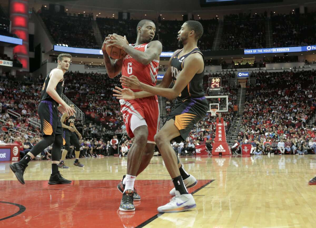 Houston Rockets forward Gary Clark (6) takes down a board against Phoenix Suns at the Toyota Center on Sunday, April 7, 2019.