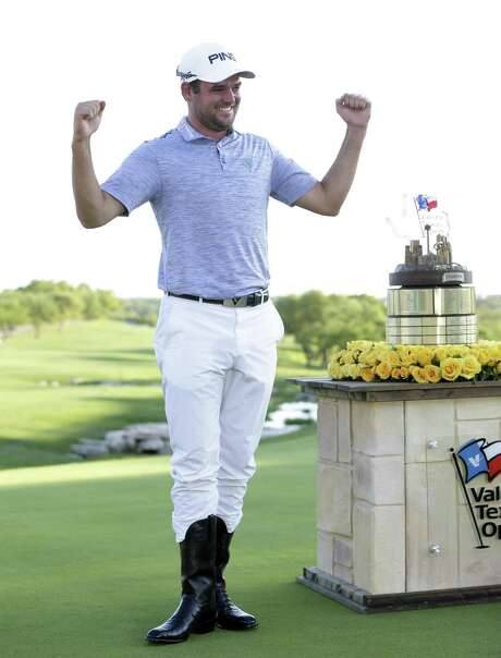 Corey Conners celebrates his victory at the Valero Texas Open final round at the AT&T Oaks Course at TPC San Antonio on April 7, 2019.