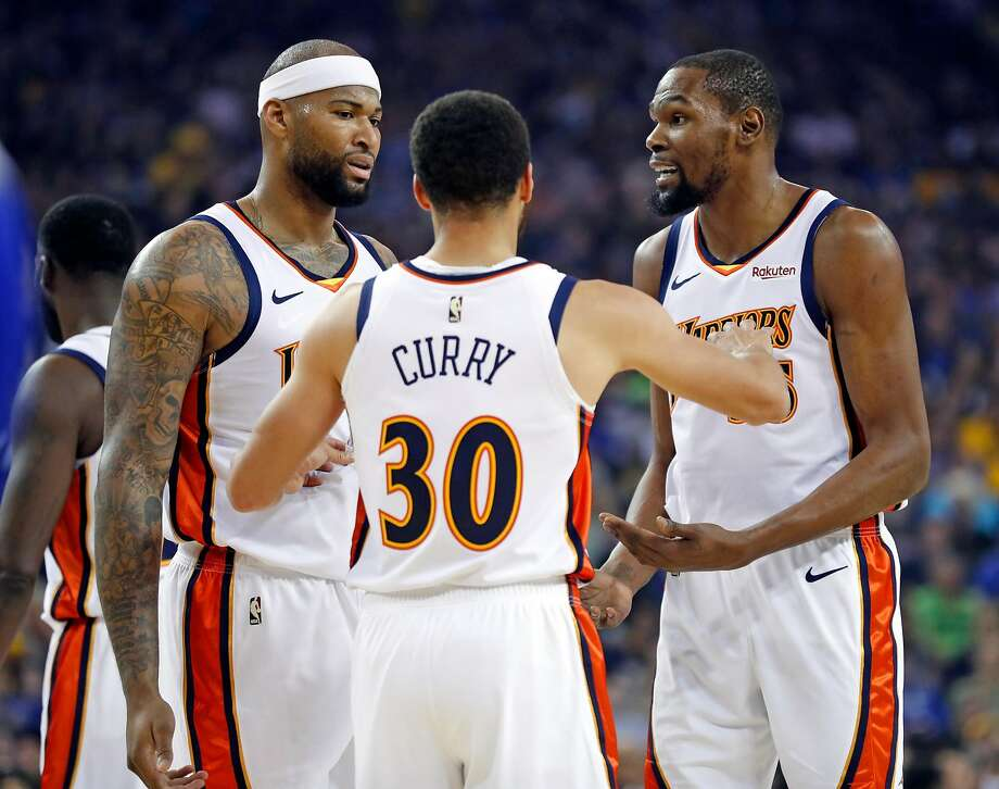 DeMarcus Cousins (left) has fit in well with teammates, including Stephen Curry and Kevin Durant (right), and if he gets a championship ring, it will be one that he has earned. Photo: Scott Strazzante / The Chronicle