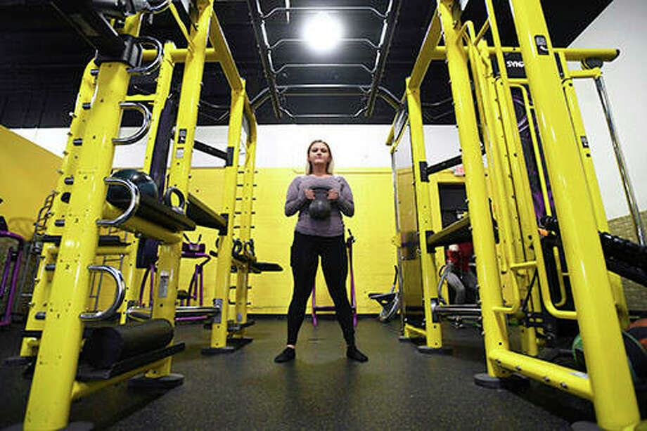 Kelsey Stauffer of Ashkum works out at Planet Fitness in Kankakee, a routine part of her now-healthy lifestyle. Stauffer, 22, has lost 100 pounds over the past two years, which prompted an excess skin-removal surgery in November. Photo: Tiffany Blanchette | The Daily Journal (AP)
