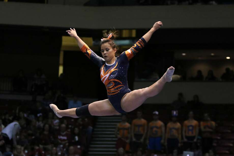 Auburn Tigers Samantha Cerio performs on the balance beam at the Elevate the Stage Meet between the Auburn Tigers and the Alabama Crimson Tide.  Alabama defeated Auburn by the score of 195.850 to 194.675  on January 29, 2017, at the Legacy Arena in Birmingham, Alabama.  Photo: Icon Sportswire/Icon Sportswire Via Getty Images