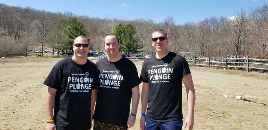 Bethel police officers Thomas Schretzenmayer and Jason Broad, right, at the Polar Plunge on Saturday. Photo: Bethel Police Department / Facebook