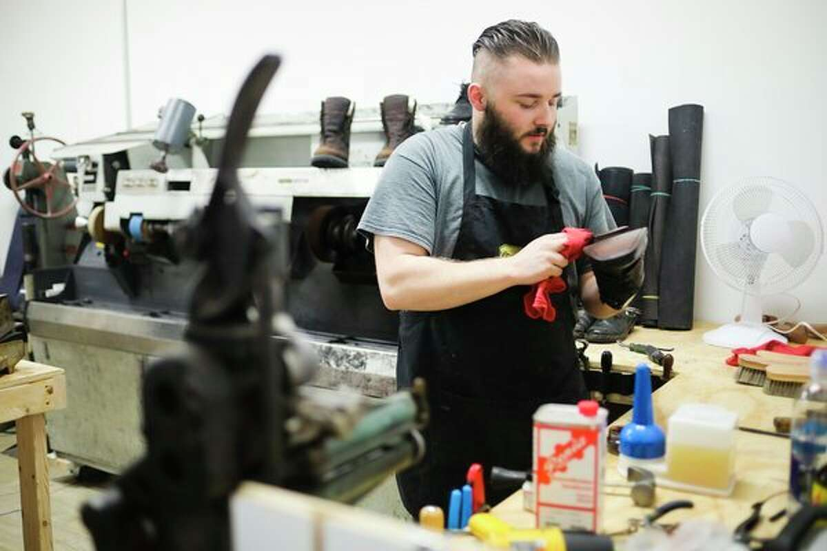 Louie Domerese works on a pair of shoes inside his shop, Louie's Leatherworks & Shoe Repair, on Friday in Midland. (Katy Kildee/kkildee@mdn.net)