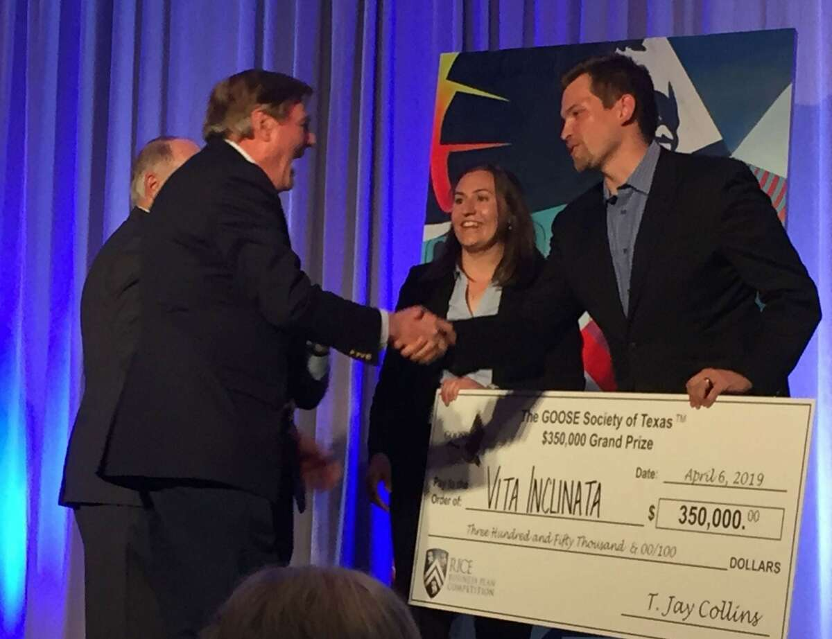 Vita Inclinata Technologies accepts a cash prize at the 2019 Rice Business Plan Competition.