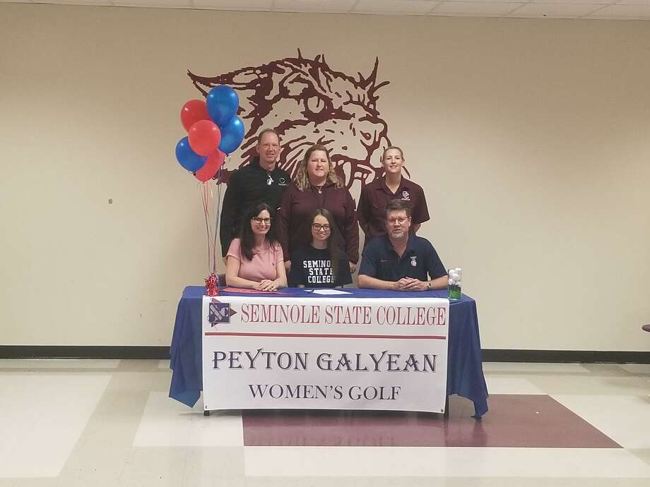 Clear Creek golfer Peyton Galyean has signed a letter of intent to play golf at Seminole State College in Oklahoma. Pictured (front row) are her mother, Christy Galyean, Peyton Galyean, father Jeff Galyean (back row) Creek principal Jamie Majewski, Lady Wildcat golf coach Kayla Williamson and Creek women's athletic coordinator Kristi Odom. Photo: Submitted Photo