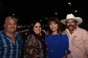 Oscar Flores, Mabely Flores, Guillermina and Julio Carrillo pose for a photo during Los Angeles Azules concert.