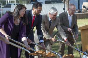 City leaders toss of shovel full of dirt 04/08/19 at the groundbreaking event for the new Centennial Park in downtown Midland. Tim Fischer/Reporter-Telegram