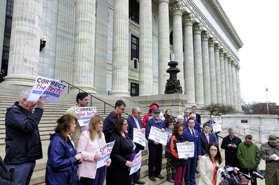 Jolene DiBrango, foreground right, executive vice president of New York State United Teachers, along with other members of NYSUT and elected officials, takes part in a protest against testing for students outside the New York State Education building on Monday, April 8, 2019, in Albany, N.Y.    (Paul Buckowski/Times Union) Photo: Paul Buckowski, Albany Times Union / (Paul Buckowski/Times Union)