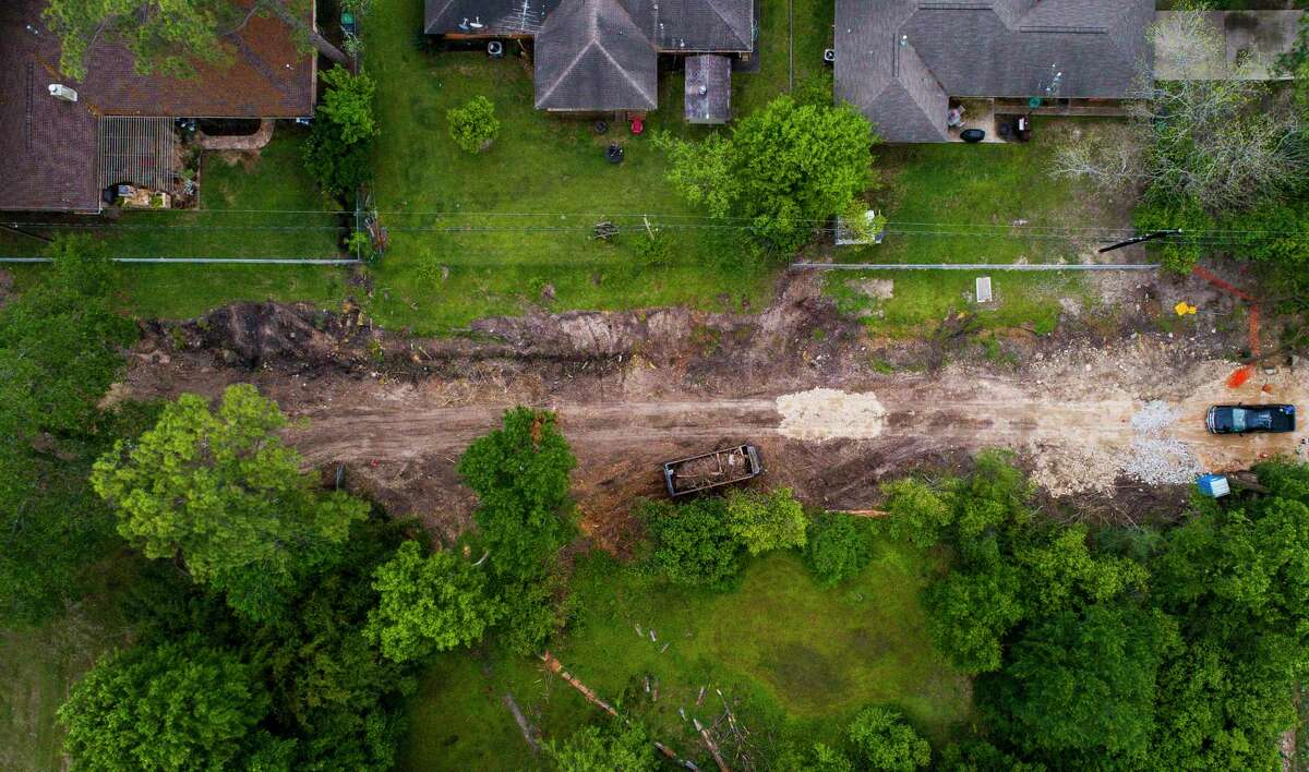 Work has started on the widening of a ditch that runs behind houses on Warwana Road in Spring Branch, Thursday, April 4, 2019. Like a lot of his neighbors, Kurt Steenson was surprised to see contractors clear-cutting a new 40-foot-wide channel in place of the shallow ditch that runs behind his Spring Branch house from where the channel starts on Witte Road. Steenson said he was under the impression that the ditch would just be cleared and deepened and that the large trees that have been growing in the easement would remain. Now Steenson has been told that he could lose approximately ten feet of his backyard if the city continues to widen the channel into the existing easement. Steenson has lived in the home over thirty years and has never experienced flooding. A lot of the homes along the ditch have fences that are about ten feet from the center of the channel.