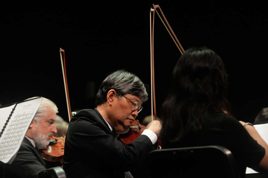 Violinist Yu Zhao Gu performs with the Symphony of Southeast Texas during a 2017 Youth Education Concert. Gu passed away after collapsing onstage Saturday, April 6, during the symphony's final concert series. Photo taken Tuesday, May 16, 2017 Kim Brent/The Enterprise Photo: Kim Brent/Beaumont Enterprise