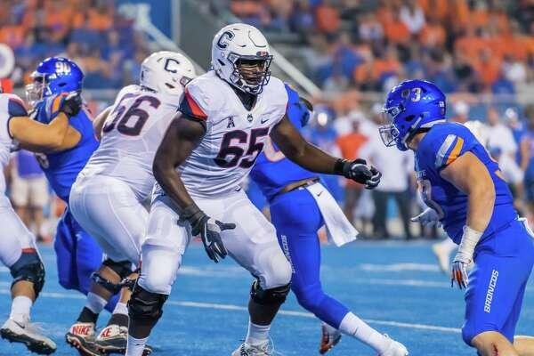 BOISE, ID - SEPTEMBER 08: Connecticut Huskies offensive lineman Matt Peart (65) sets up a block from Boise State Broncos defensive tackle Chase Hatada (93) during the game between the Connecticut Huskies vs the Boise State Broncos on Saturday, September 8, 2018, at Albertsons Stadium in Boise, Idaho. (Photo by Douglas Stringer/Icon Sportswire via Getty Images)