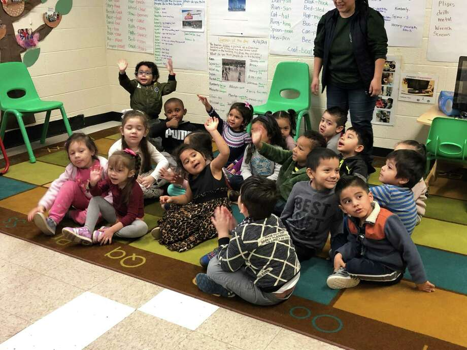 Preschool students in Nora Roberts' class in the Greater Norwalk Head Start program welcomed guest readers this week as a part of the National Week of the Young Child on Monday, April 8, 2019. Photo: Kelly Kultys / Hearst Connecticut Media /