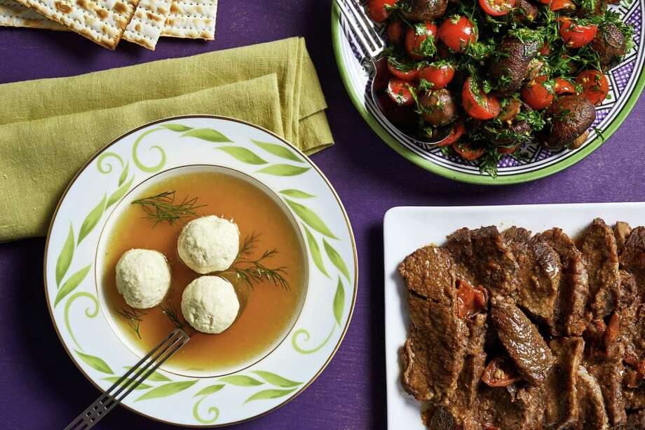 A lighter Passover menu: Not-Quite Matzoh Ball Soup; Roasted Mushroom, Tomato and Herb Salad; and Traditional Brisket. Photo: Photo By Stacy Zarin Goldberg For The Washington Post; Food Styling By Lisa Cherkasky For The Washington Post. / For The Washington Post