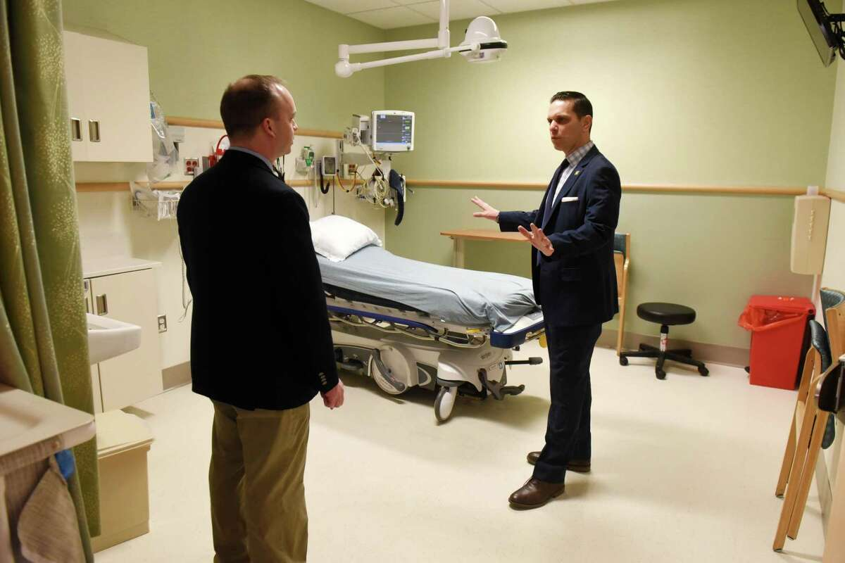 Assemblyman Angelo Santabarbara, right, tours the Ellis Hospital Emergency Department with department chair, Dr. Robert McHugh, left, on Monday, April 8, 2019, in Schenectady, N.Y. Assemblyman Santabarbara helped to secure state funding for a pilot program to create a sensory-friendly ER for its autism patients, with hopes of easing agitation and reducing hospital stays. (Will Waldron/Times Union)