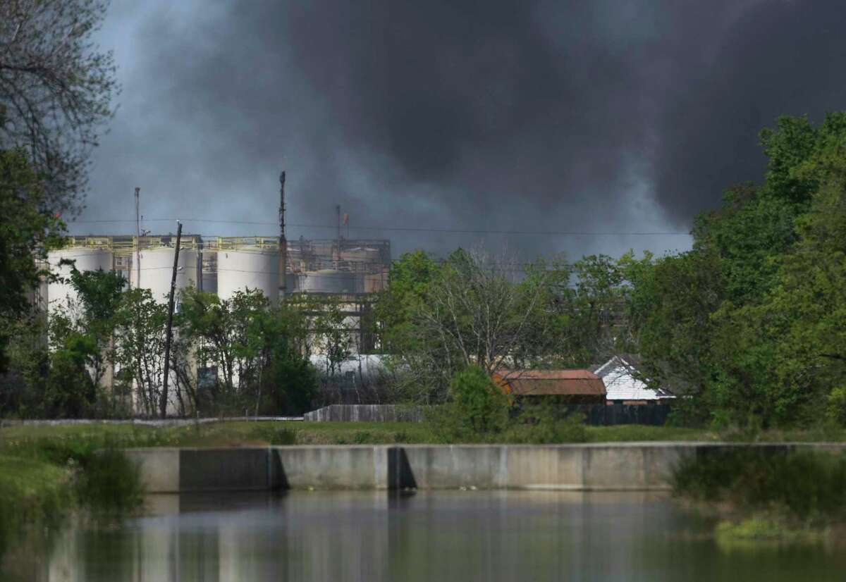 A plume of smoke rises over a fire at the KMCO plant following an explosion Tuesday, April 2, 2019, in Crosby, northeast of Houston, Texas.