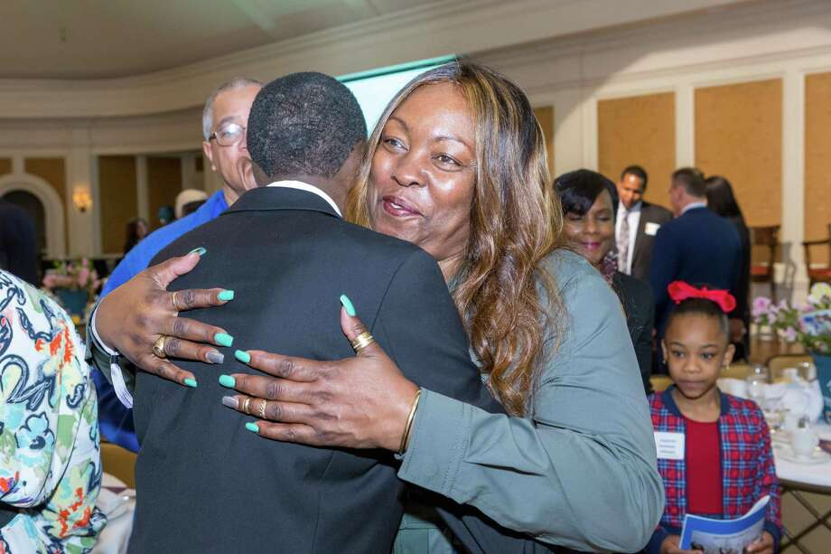 At the Rise & Shine with Boys & Girls Clubs Spring Breakfast at the River Oaks Country Club on March 29, keynote speaker Monja Willis embraces Cort Keener, the 2019 Youth of the Year. Photo: Photo ByDaniel Angulo