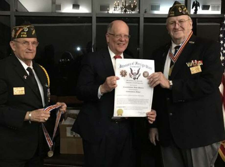 Precinct 3 Fort Bend County Commissioner Andy Meyers received the Commanders Award from the Katy Veterans of Foreign Wars Post 9182. From left are Tony Hart, senior vice commander; Meyers and Don Byrne, commander. Photo: Karen Zurawski / Karen Zurawski