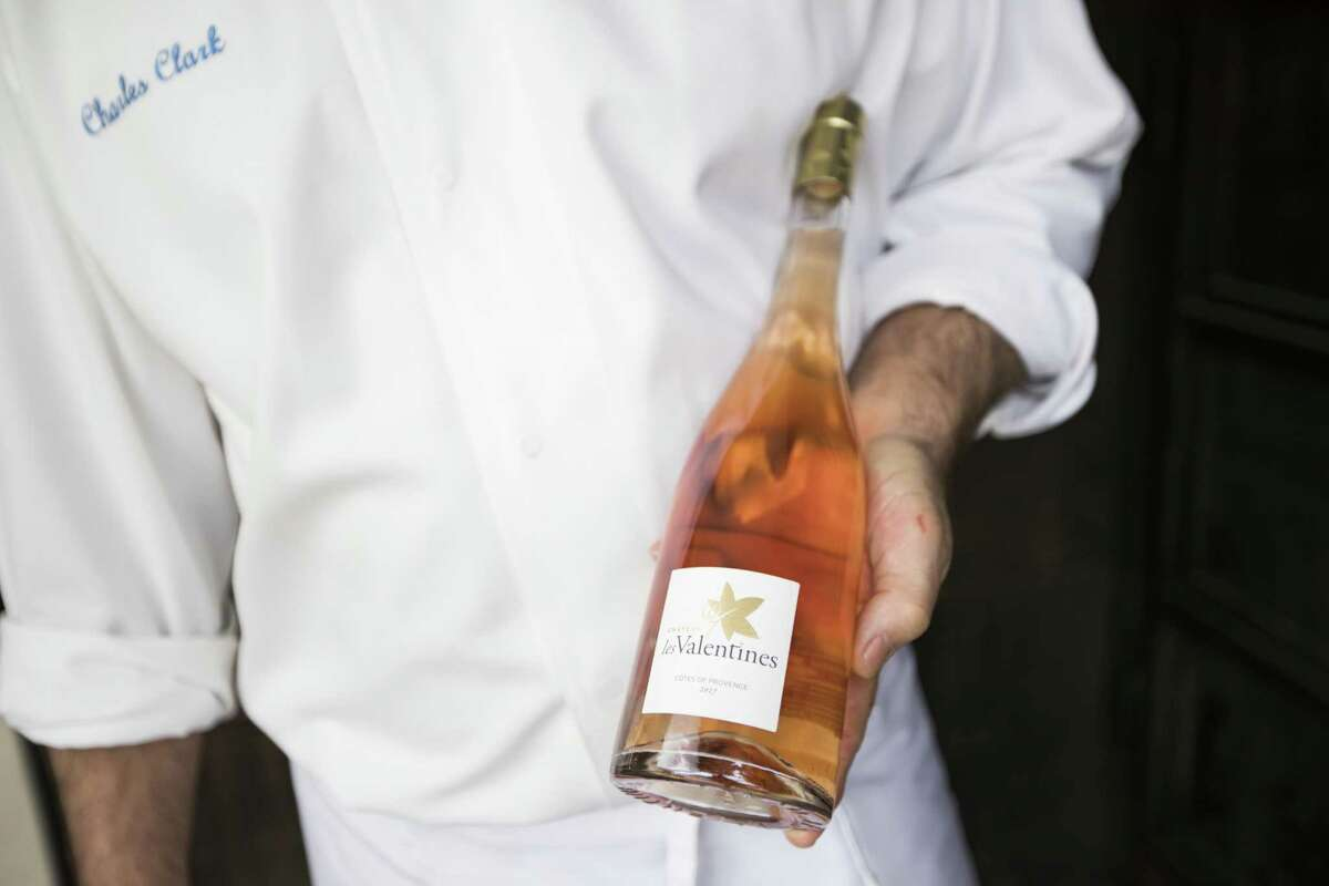 Ibiza chef-owner Charles Clark holds a bottle of 2017 Château les Valentines Côtes de Provence Rosé