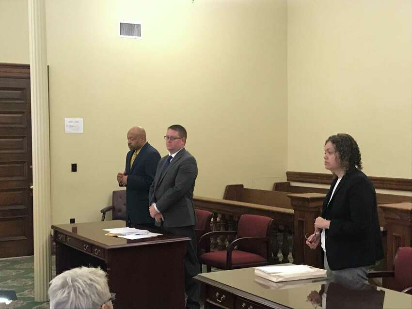 From left, retried Troy Detective Aaron Collington, , his defense attorney Joseph Ahearn, and Special Prosecutor Linda Griggs in Rensselaer County Court Monday April 8, 2019 for Collington's guilty plea to stealing $6,200 from the Troy Police Benevolent Association while he was president.