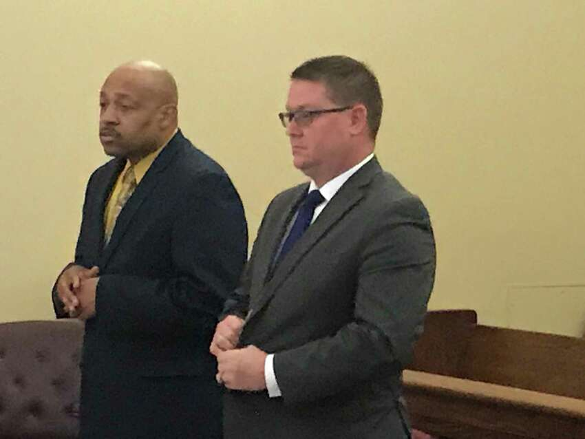 Retired Troy Detective Aaron Collington, left, appears with his attorney Josepha Ahearn Monday April 8, 2019 to plead guilty in Rensselaer County Court.