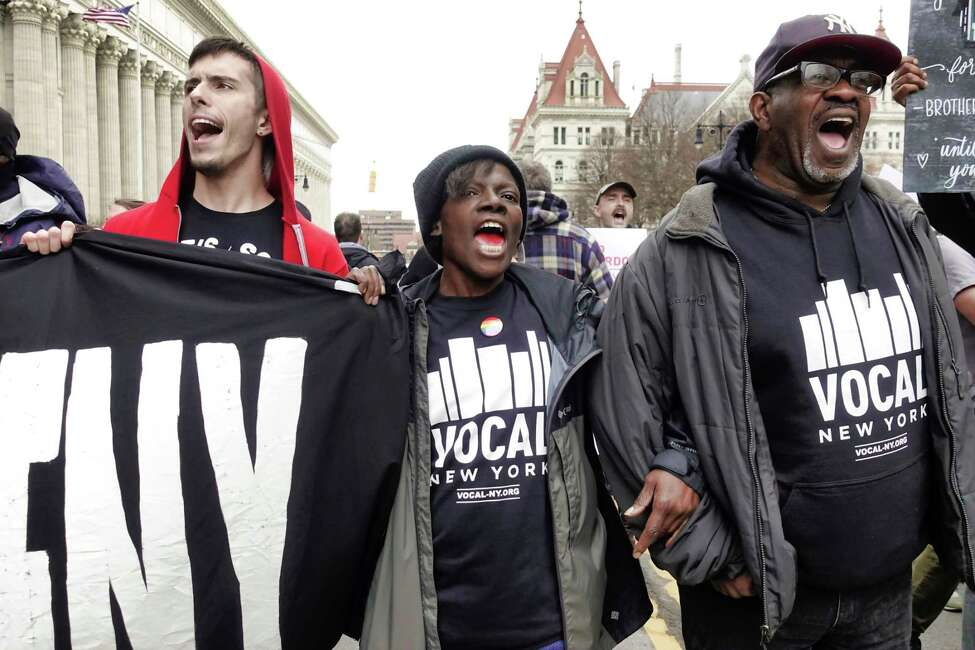 Protestors block Washington Ave. outside the Medicaid Office on Monday, April 8, 2019, in Albany, N.Y. Members of Vocal-NY, End Overdoes New York, and Truth Pharm were calling for universal access to medication-assisted treatment (MAT) to end the overdose crisis. The protestors were also highlighting the critical and persistent problems with Medicaid that hinder MAT access. (Paul Buckowski/Times Union)