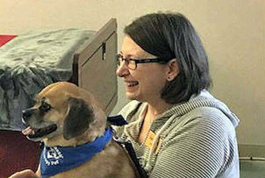 Trainer Cheryl and therapy dog, Lexie. Photo: Courtesy Of Family Hospice
