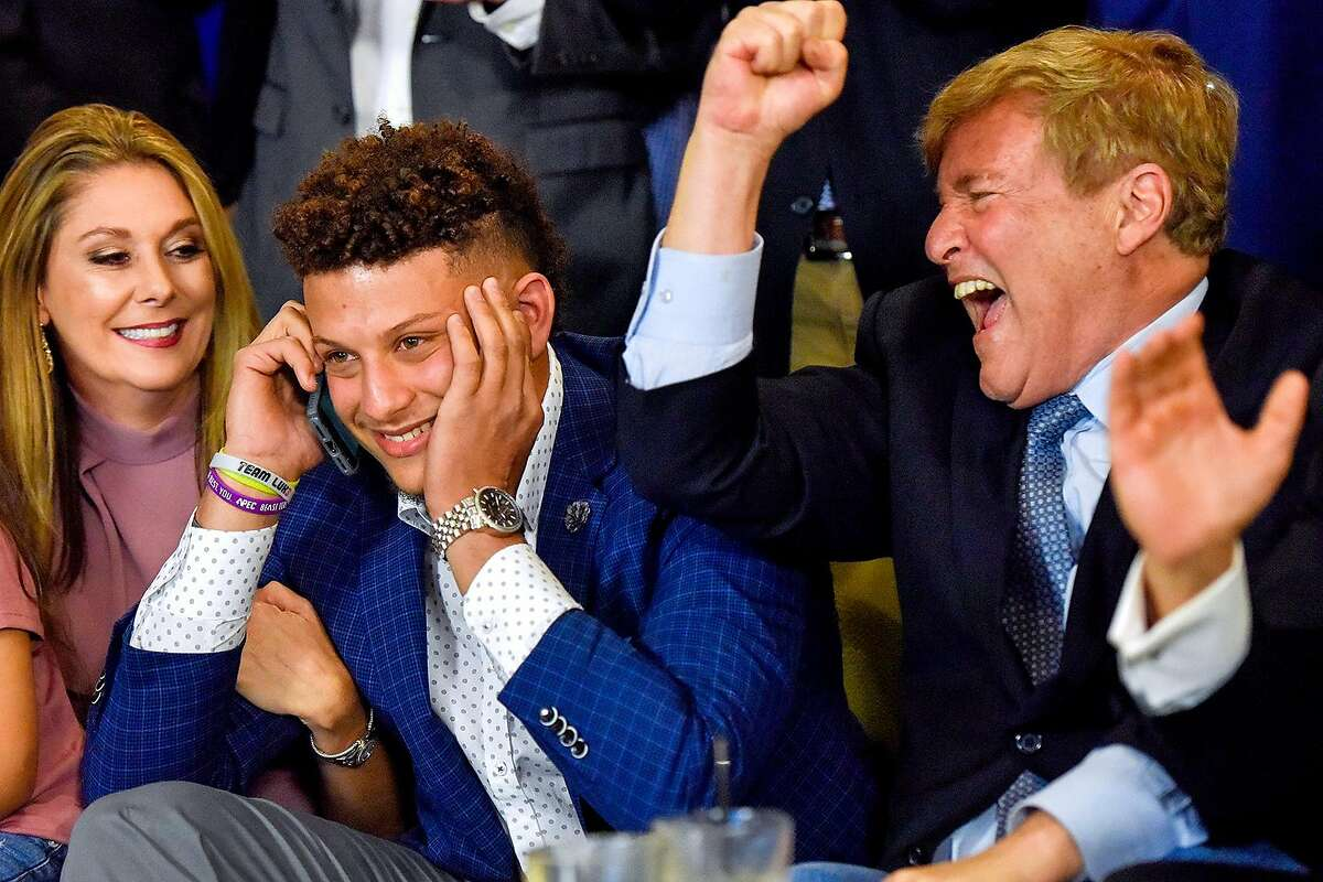 Randi Martin, Patrick Mahomes II and Leigh Steinberg react while Patrick is on a call with the Kansas City Chiefs during an NFL Draft watch party at Lago del Pino in Tyler, Texas, on Thursday, April 27, 2017. Mahomes II was the tenth overall pick in the first round of the NFL draft for the Kansas City Chiefs after a trade with the Buffalo Bills. (Chelsea Purgahn/Tyler Morning Telegraph)