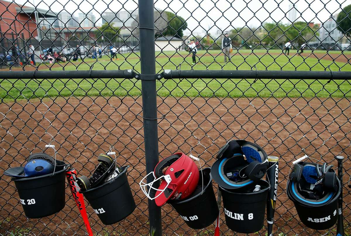 The Stratford Fire Lions play a youth baseball league game against the Commodore Sloat Seals at Victoria Manalo Draves Park on Folsom Street in San Francisco, Calif. on Saturday, April 6, 2019. Neighbors are concerned that a planned seven story residential project constructed at Folsom and Russ streets would create shadows on the park.