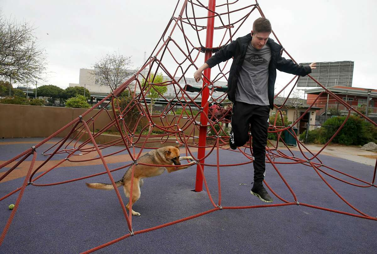 Justin K. and his dog Delta have fun in Victoria Manalo Draves Park on Folsom Street in San Francisco, Calif. on Saturday, April 6, 2019. Neighbors are concerned that a planned seven story residential project constructed at Folsom and Russ streets would create shadows on the park.
