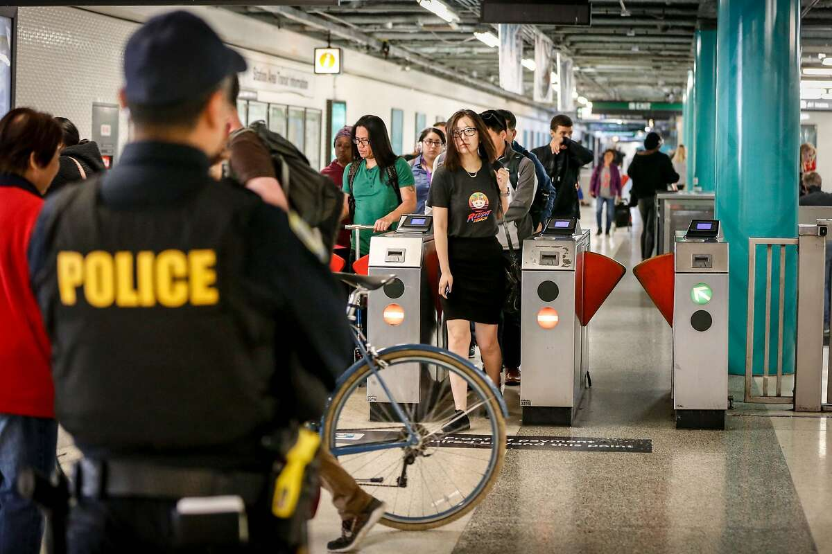 Police officer S. Nho stands guard at Powell Station BART entrance watching for fare evaders as part of BART's large-scale fare evasion enforcement action on Monday, April 8, 2019 in San Francisco, Calif.