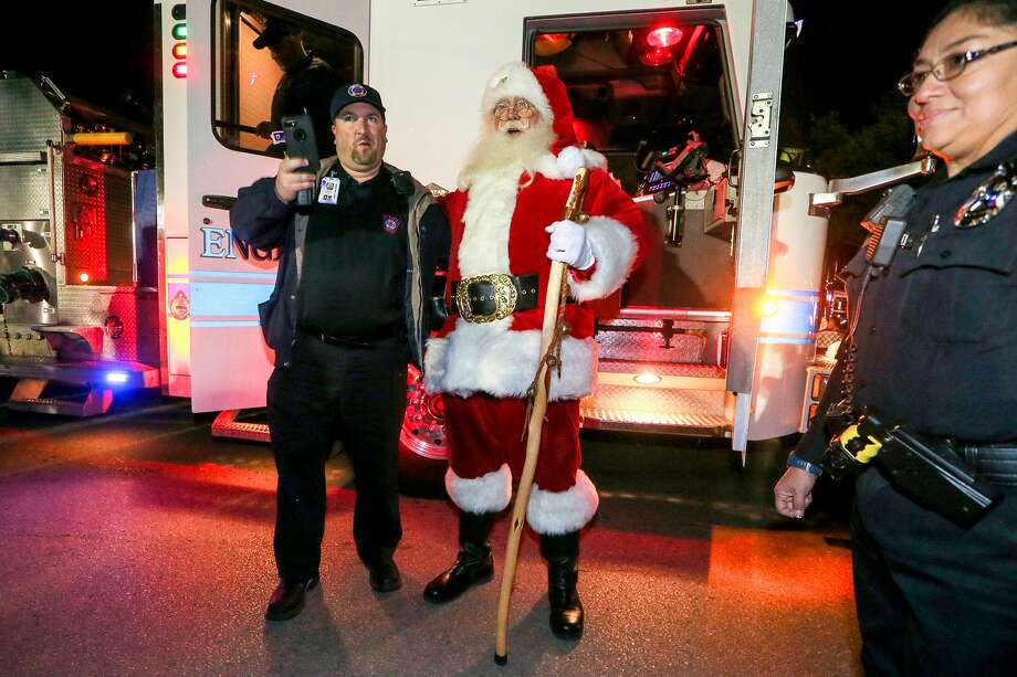 Santa Claus played by Jim Flinn, arrives on a fire engine at the 59th Annual City of Windcrest Light Up Celebration at City Hall in December 2017. Last week, Flinn was appointed by the Windcrest City Council to the vacant Place 1 seat. Photo: Marvin Pfeiffer /San Antonio Express-News / Express-News 2017