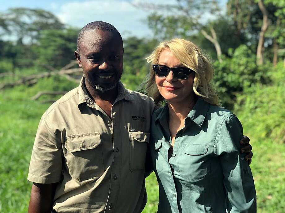 Image released by Wild Frontiers tour company on Monday April 8, 2019, shows American tourist Kim Endicott, right, and field guide Jean-Paul Mirenge a day after they were rescued following a kidnapping by unknown gunmen in Uganda's Queen Elizabeth National Park. Ugandan police said they had rescued Endicott, an American tourist, and her guide, Mirenge, who had been kidnapped by gunmen in a national park. Photo: Associated Press