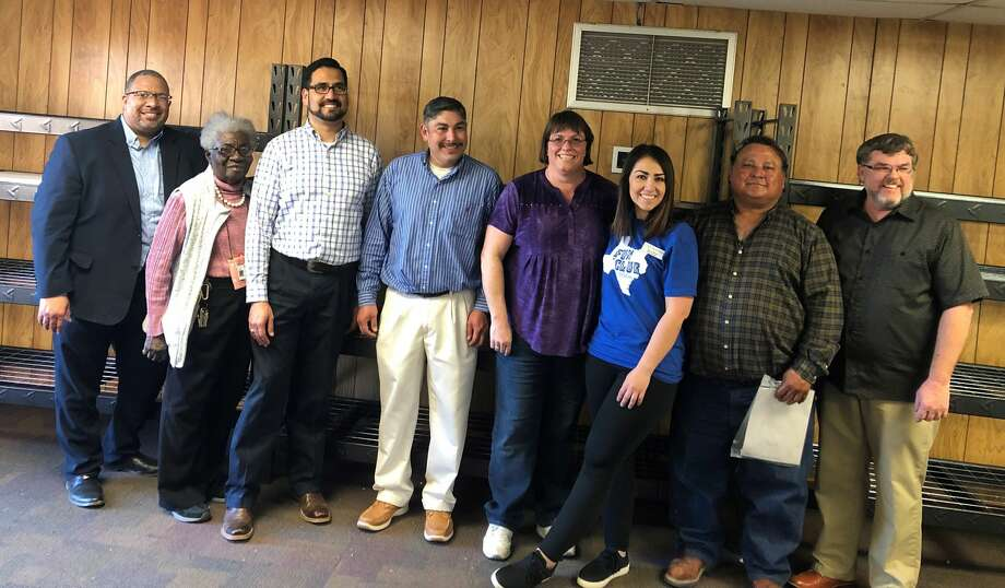 Midland Hispanic Leadership Group members are: Pervis Evans, from left, Barbara Yarbrough, Luis Sanchez, Juan Dominguez, Deonne Presley, Becca Myers, Arturo Carrasco and Mike Mills. Photo: Courtesy Photo