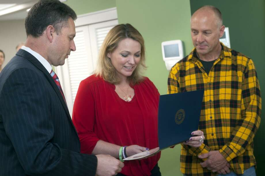 Robert Fuller, Assistant Special Agent in Charge of the FBI's New Haven Field Office presents Nicole Hockley and Mark Barden, of Sandy Hook Promise, with FBI Director's Community Leadership Award at Sandy Hook Promise's headquarters in Newtown, Conn. April 8, 2019. Photo: Ned Gerard / Hearst Connecticut Media / Connecticut Post