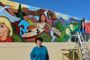 Artist Janet Pontius has painted a mural on an exterior wall of the Cogdell Learning Center.