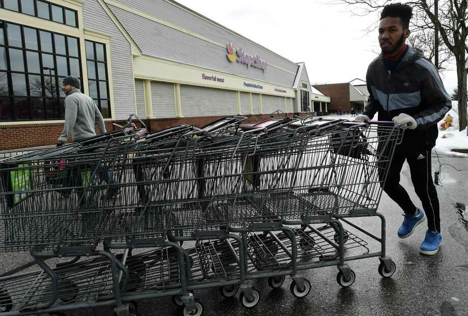 Employees of Stop and Shop gather carts in the parking lot in March on Main Avenue in Norwalk. Photo: Erik Trautmann / Hearst Connecticut Media / Norwalk Hour
