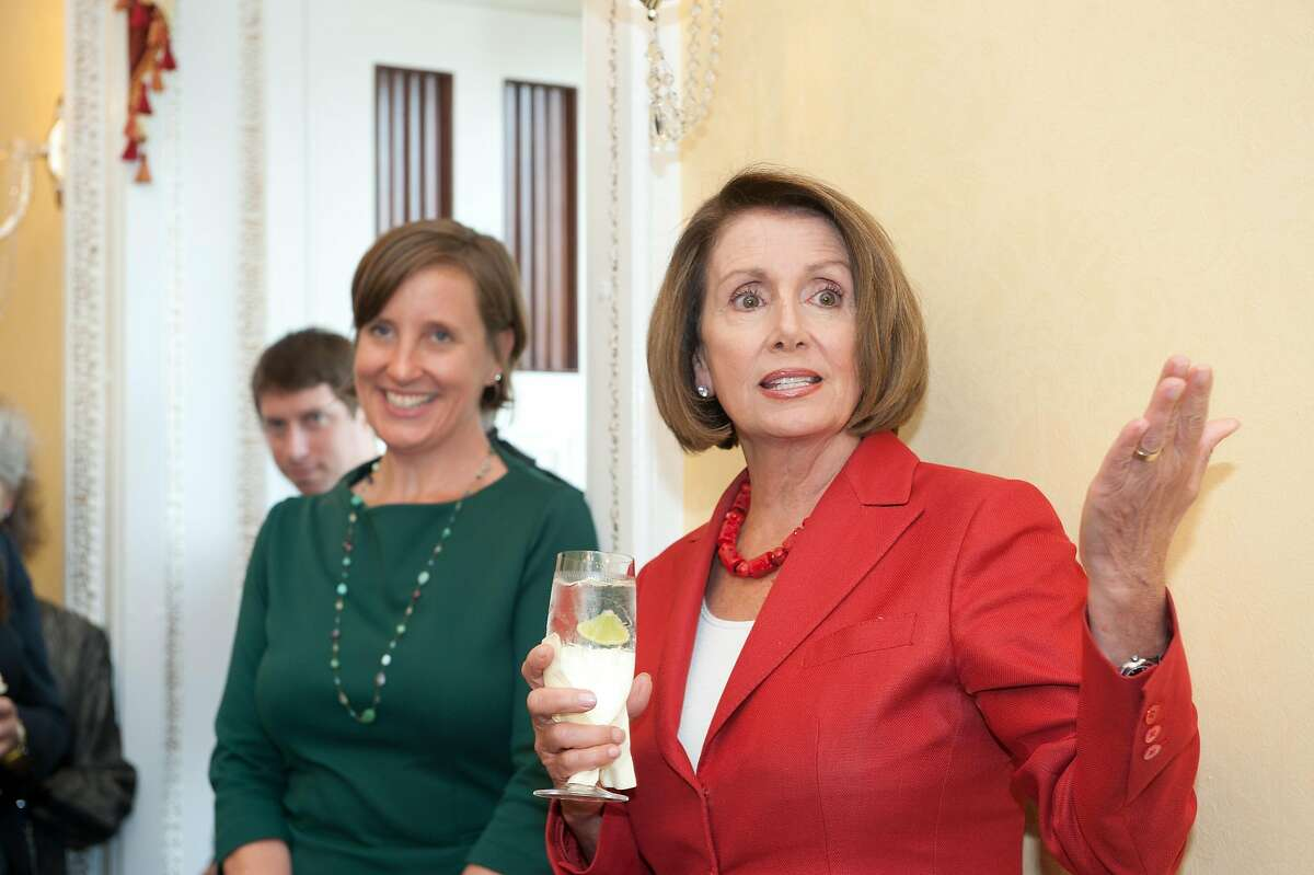 House Speaker Nancy Pelosi, D-San Francisco, toasts her outgoing chief of staff Terri McCullough at a going away party in 2013.